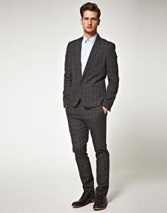 Oh, the wonders a tailored suit can do for a man!