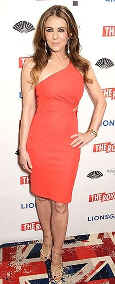 The Royals star oozed sophistication in a one-shouldered orange dress with gold strappy heels.