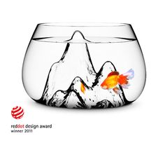Aruliden Glasscape. Transforming the traditional fishbowl into a beautiful new icon for the home. Winner of the Red Dot Design Award, each bowl is a unique piece, individually hand blown.     The textured interior evokes the feel of a rugged landscape, creating the perfect environment for plants to pets alike.