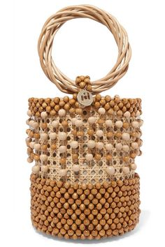 Rosantica's 'Cora' bag has been handmade in Italy from natural wicker and chunky wooden beads. The removable canvas pouch inside is secured with a drawstring to ensure even small essentials stay secure. Novelty Handbags, Purses And Handbags, Straw Handbags, Beaded Bags, Beaded Bracelets, Crochet Purses, Trendy Accessories, Bead Crochet, Loom Beading