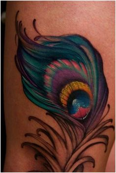 peacock feather tattoos love the colors!
