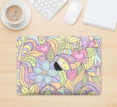 """The Vibrant Color Floral Pattern Skin Kit for the 12"""" Apple MacBook from DesignSkinz"""