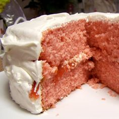 """Strawberry Cake, tastes best with whipped cream icing!  I just keep the two 9"""" cakes separate and add the fresh pureed strawberries to my mix. http://allrecipes.com/recipe/strawberry-cake-from-scratch/"""