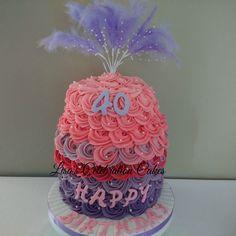Three tiered vanilla birthday cake with buttercream rose swirls.