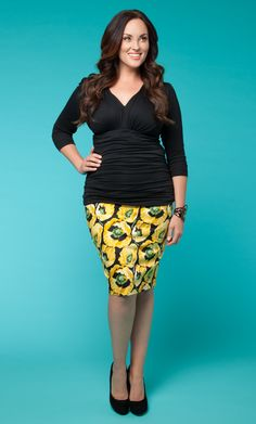 You've got the bright ideas at work and your outfit shows it!  The Plus Size Poppy Pencil Skirt by Kiyonna in yellow looks super smart when paired with a simple black top and black pumps. #plussize #kiyonna