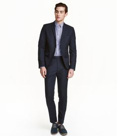 Dark blue. Suit pants in woven, viscose-blend fabric. Concealed hook-and-eye fastener, side pockets, welt back pockets with button, and creases. Slim fit.