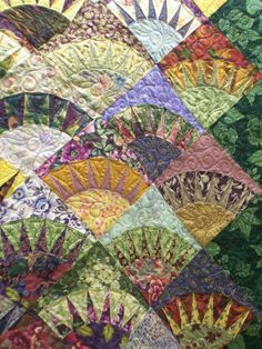 Gorgeous New York Beauty quilt posted in a blog. Don't know the maker.