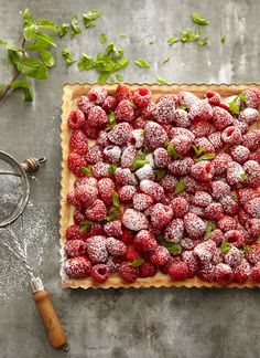 The flavor of mint in moderation is wonderful with berries. Right before serving this strawberry and raspberry tart, I like to scatter tiny mint leaves on it, then lightly dust it with confectioners' sugar.