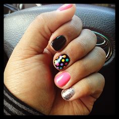I like the polka dot nail and the ring finger one of those colors... But then a black on the other 3 fingers