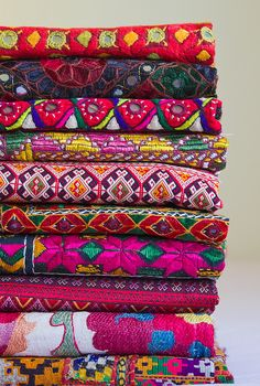 Wonderful colors on these woven textiles.