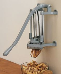 """This simple-to-operate manual cutter features a stainless steel trough,  sturdy frame and pusher block and a cast-iron handle.  Will cut potatoes  up to 6"""" long.  Available:  Cutter, Optional 1/4"""" Cutting Plate, Optional 3/8"""" Cutting Plate."""