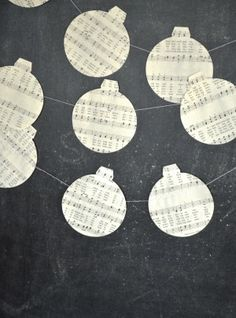 This handmade Christmas Ornament Garland in vintage music papers will be a lovely addition to your celebration and home decor!