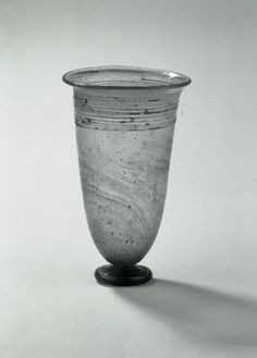 Glass stemmed beaker, clear green.  Early Anglo-Saxon, 5th c.  Howletts cemetery, Littlebourne, Kent.  Ht 11.2 cm.  British Museum.