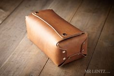Once there was a day when all a man carried in his toiletry bag was a straight razor and a toothpick. Well, times have changed and so has the load, which is why I put together the most rugged and durable toiletry bag for the modern man. Handmade from scratch using the best Full-Grain Vegetable-Tanned leather and solid brass hardware, this dopp kit will not wear out. With no threading to break, you can enjoy it for a lifetime. Two snaps keep it closed tight and a handle will help you throw it…