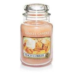 Peach Cobbler : Large Jar Candles : Yankee Candle : Always the perfect ending to a summer meal, homemade peach cobbler topped with vanilla ice cream captures the essence of the season. This fragrance will bring to mind fresh-picked peaches from the farmer's market, perfectly baked with cinnamon, nutmeg and honey sugar, and generously served with a scoop of your favorite vanilla ice cream.