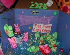 "2013: Zombie Peeps vs. Easter Bunnies Egg Hunt Gone Dead.  Entering this for my 9-year-old daughter Breyana. She likes Zombies like her Daddy so she came up with this Zombie Peeps vs. Easter bunnies! Love all the little details like the toothpick bow & arrow, egg bomb basket and the ""blood & scars"" she painted herself."