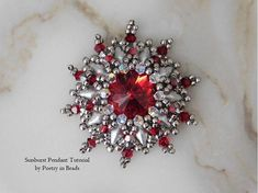 Sunburst Pendant Tutorial by Poetry in Beads with Swarovski and diamonduos, silver and red