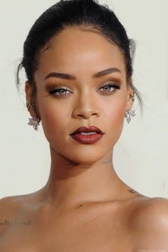 Best Dark Lipsticks for Daytime Looks | Rihanna's 10 Best Beauty Looks, check it out at http://makeuptutorials.com/rihanna-beauty-makeup-tutorials