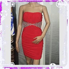 Very cute red dress with rhinestones. Very cute and very pretty red dress with rhinestones. Brand-new. Size medium. Very figure flattering. Right in time for summer. Dresses
