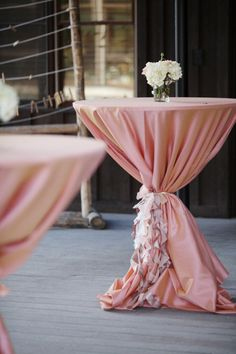 Pink linen tied with pink ruffled fabric for cocktail tables. Photography by jennawalkerphotography.com, Floral