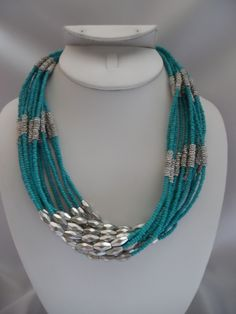 Visit: hipandcoolcliponearringstwo.com and receive up to 30% off. TURQUOISE & SILVER MULTI STRAND SEED BEAD NECKLACE $14.99 http://hipandcoolcliponearringstwo.com