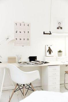 Very simplistic bright white desk space. Studio at home.