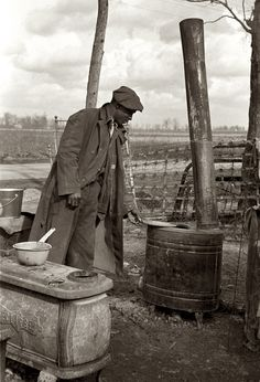 """January 1939. An evicted sharecropper among his possessions in New Madrid County, Missouri. 35mm photo by Arthur Rothstein. """"On January 10, 1939, in the bootheel region of southestern Missouri, some 1700 sharecropper families were handed eviction notices for their protest of planters' plans to reduce them to day laborers."""" Basically a result of the mechanization of agriculture. No need to have dozens of sharecroppers farming your land with mules when a few men on tractors can do the same work."""