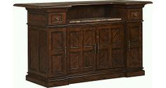 The perfect front #bar for your #cocktail #party. Complete with a removable wine rack that keeps bottles or larger items safe. An inlaid marble top provides an ornate serving space. From #Havertys.