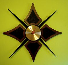 chartreuse wall, vintage spiky star clock. Mid Century Modern atomic