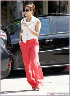 Eva Mendes wearing Rodarte X Opening Ceremony Spring 2011 Off White Net and Fuzzy Cardigan, Prada Spring 2011 Ankle Strap Platform Sandals, Alice + Olivia Coral High Waist Wide Leg Pant, Prada Baroque Round Graphic Sunglasses and Marni Stud-Trimmed Leather Shoulder Bag.