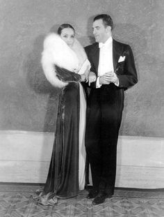 Dolores Del Rio and Cedric Gibbons arrive at the Mayfair Ball....
