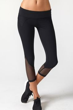 Our BEST SELLING essential capri.  A sleek fashion-forward cropped legging with mesh insets at hips and calves. Comfortable second skin like fabric.  Mid-rise,