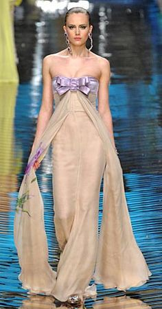 Valentino couture strapless gown in ecru.  Lavender silk banded bow detail.  Flowing chiffon with lavender floral print.  Gorgeous.