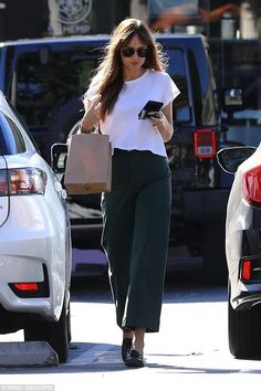 Dakota Johnson Keeps It Casual for Trip to Earthbar in WeHo: Photo Dakota Johnson puts her casual style on display while running errands. The Fifty Shades of Grey actress was spotted picking up some items at Earthbar… Estilo Dakota Johnson, Dakota Johnson Street Style, Dakota Style, Dakota Jhonson, Look Fashion, Teen Fashion, Fashion Outfits, Womens Fashion, Fashion Trends