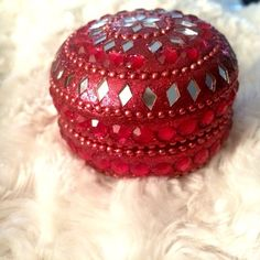 Candy Apple Red❤️Trinket Box❤️ Beautiful candy apple red trinket box❤️Adorned in red beading with diamond shaped mirrors.❤️black velvet lines lid and bottom❤️ Leaving items scratch free❤️Bundleno trades❤️bought at Pier One Imports❤️used as accent piece only on vanity❤️for jewelry etc. 2 1/2 in. circumference 1 1/2 in. height❤️ Pier One Jewelry