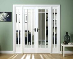 Interior sliding French doors with two matching sidelights This a