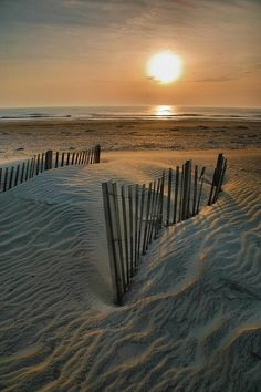 The sun rises over...#beach #photography