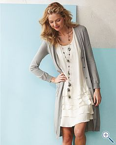 I have a sweater just like this.  Love the necklace/dress combo with it... just gotta find em haha