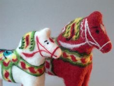 These horses are made of wool in a technique called needle felting. They are inspired by the traditional wooden dalahorse, the symbol of Sweden.
