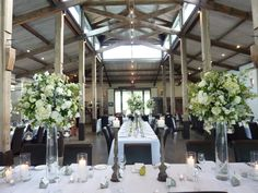 Tall vases with beautiful flower balls & hanging tealights. | by Flower Jar