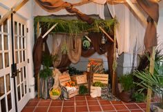 "The ""Back to Bethlehem"" street market creche exhibit started outside the front doors of the church.  The patio entrance, under a draped wood canopy, welcomed visitors into the street market-themed nativity show.  (Simi Valley, California, December 2012)  #nativity"