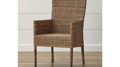 Tigris Dining Arm Chair and Natural Cushion | Crate and Barrel