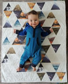 Photo-print triangles pieced into a quilt.