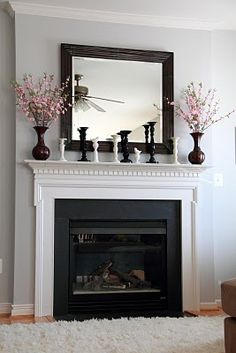 LOVVVE the combo of the grey walls with white trim, black/white decor & a splash of pink -so mod yet so refreshing/ crisp.  Paint colour: Stonington Grey