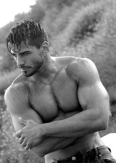 Poor drenched shirtless hunk. He looks so chilly, standing there in the rain with all those muscles. I'd keep him warm.