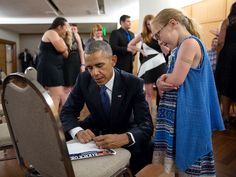 """July 12, 2016 """"President Obama signs a note for Samantha Thompson, niece of DART Officer Brent Thompson, one of five police officers who was killed in Dallas in July. The President and Mrs. Obama visited with families of the officers and other victims following an interfaith memorial service in Dallas."""" (Official White House Photo by Pete Souza)"""