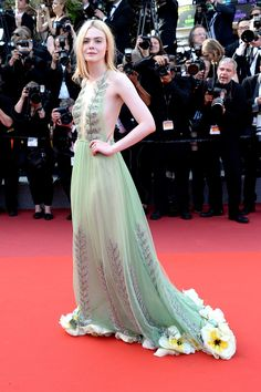 "Actress Elle Fanning attends the ""How To Talk To Girls At Parties"" screening during the annual Cannes Film Festival at Palais des Festivals on May 2017 in Cannes, France. Elle Fanning, Dakota Fanning, Oscar Dresses, Prom Dresses, Wedding Dresses, Celebrity Outfits, Celebrity Style, Robes D'oscar, Gucci Gown"