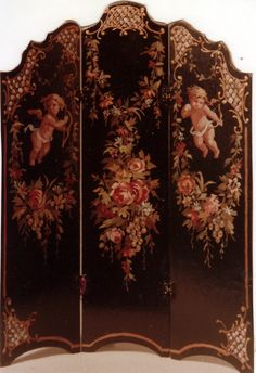 A decadent decoupaged screen adorned with floral garlands.