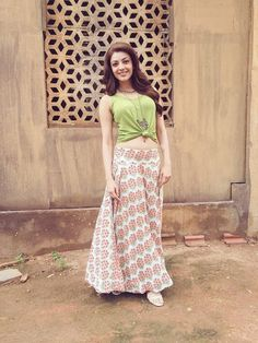 Kajal Agarwal in long skirt and crop top