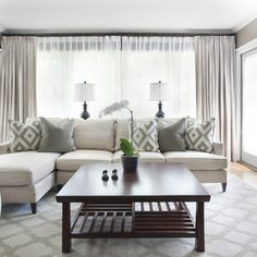 Sectional with lamps in front of window